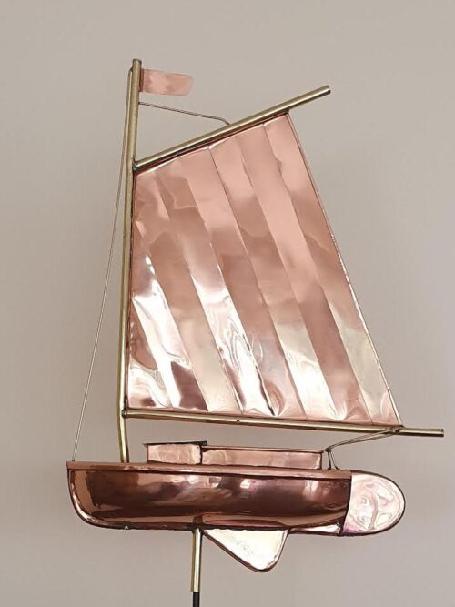 Catboat with a single mast well forward in the bow